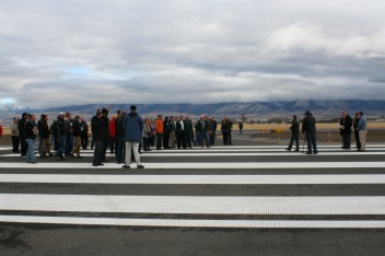Attendees gather at the end of the runway for the opening ceremony on Oct. 26, 2017.